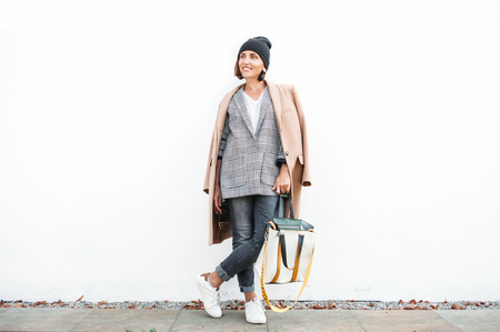 City street fashion look. Woman dressed in multilayered outfit for autumn days