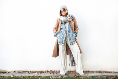Woman posing in multilayered autumn outfit