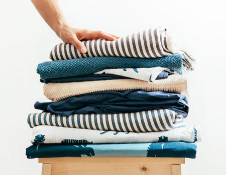 Blue and beige textile laundry for cozy home Banco de Imagens