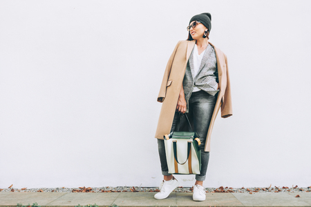 Street fashion look. Female multilayered outfit for autumn days