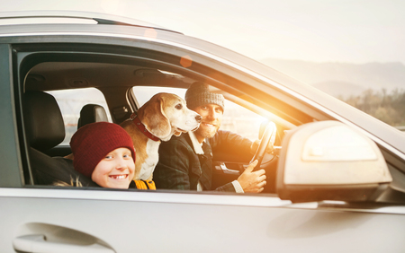Father with son and beagle dog traveling together by auto right door angle shoot