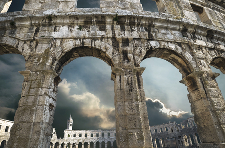 Pula amphitheater arches with thunder sky