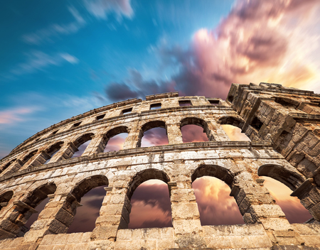 Famous Pula Amphitheatre in Croatia with dramatic sky Banco de Imagens