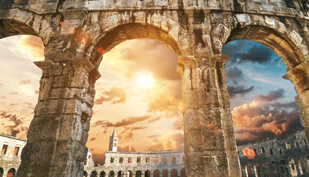 Pula amphitheater arches with sunset sky Banco de Imagens