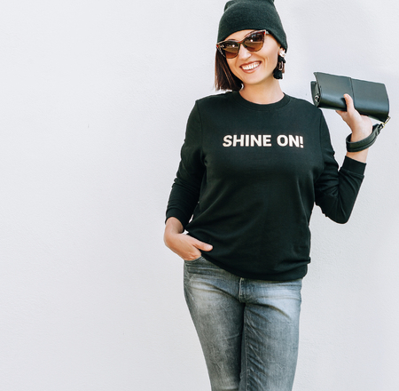 Smiling caucsaian woman in trendy casual grey black outfit for spring summer days. Sweatshirt with funny positive print. Stock Photo
