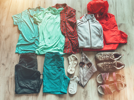 Set necessary clothes for female hiking: shorts,pants,trekking socks, thermal top, t-shirts,fleece jacket, boots, sandals
