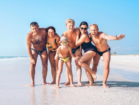 Happy family on the sandy sea beach