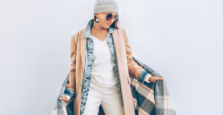 Woman dressed elegant outfit with oversize denim jacket .  Modern fashion outfit concept image. Stock Photo