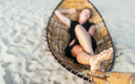Local focus woman lying in hammock feet image. Feet skin health concept image 版權商用圖片