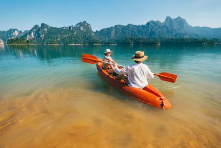 Mother and son floating on kayak together on Cheow Lan lake in Thailand 版權商用圖片