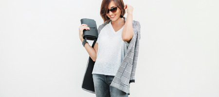 Woman dressed gray and white casual outfit with checkered jacket 版權商用圖片