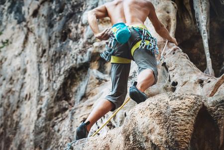 Mountain climber on Climbing Route on Tonsay beach in Krabi, Thailand.