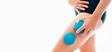 Female making massage using a silicone cup for vacuum cupping anti-cellulite Massage Therapy