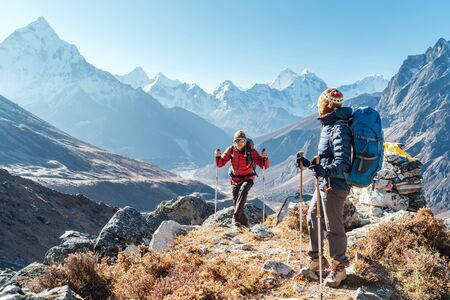 Couple following Everest Base Camp trekking route near Dughla 4620m.