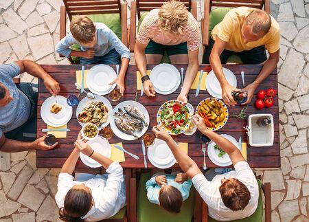 Big multi-generational family dinner in process.