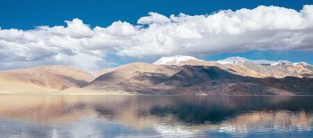 Himalayan mountains mirrored reflected in Tso Moriri mountain Lake water surface near Karzok or Korzok village in the Leh district of Ladakh, India. Фото со стока