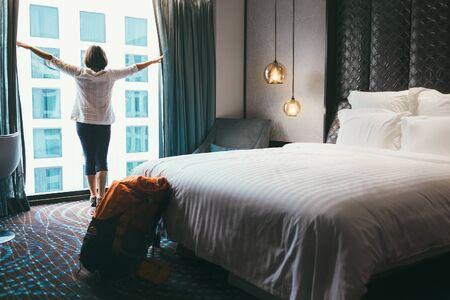 Backpacker female accommodating in 5 stars luxury hotel.