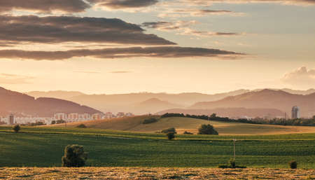Stunning evening Zilina city view in western Slovakia covered with sunset light. Traveling in Europe concept image. 免版税图像