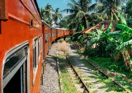 Scenery railway road from Colombo to Matara. The train goes by jungles, local villages .. Sri Lanka, December 2017