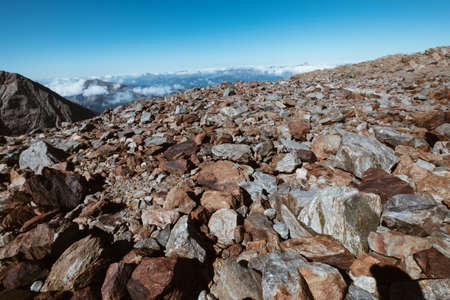 French Alps breathtaking rocky stones field landscape. Mont Blanc ascedding French trekking route. Standard-Bild