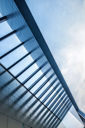 Urban Geometry, looking up to the building. Modern architecture, concrete, and glass. Abstract architectural design. Artistic minimalism image. Modern architecture concept image. 免版税图像