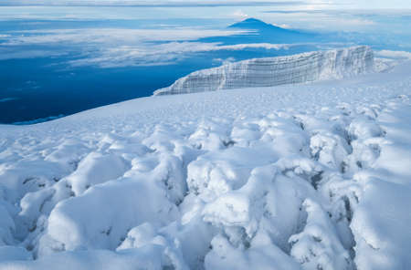 Magic breathtaking view to Snows of Kilimanjaro volcano and glaciers with Mount Meru 4562m silhouette. 5895m - the highest point of Africa and the highest single free-standing mountain in world