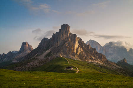 Beautiful early morning Dolomites Alps mountain landscape photo. Giau Pass or Passo di Giau - 2236m mountain pass in the province of Belluno in Italy. 免版税图像