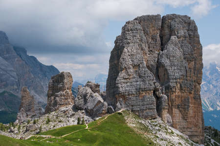 Stunning, impressive and picturesque Cinque Torri formation cliffs 2361m - popular climbers spot with Dolomite Alps panorama. Extreme Active people and mountains concept.