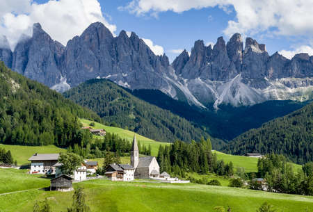 Santa Maddalena village view with stunning picturesque Dolomite Alps peaks in Val di Funes valley, South Tyrol, Italy.