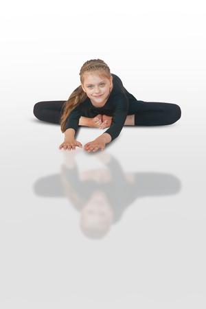 baddha: little girl doing yoga on white background