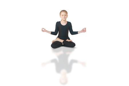 dhanurasana: little girl doing yoga on white background