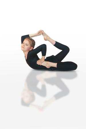 flexure: little girl doing yoga on white background