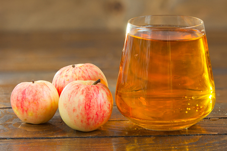 Delicious fresh squeezed apple juice in a transparent glass