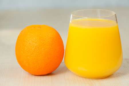 yourself: Delicious fresh squeezed Orange juice in a transparent glass Stock Photo