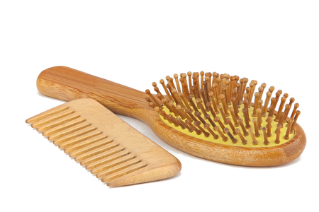comb: wooden bamboo comb for hair care on white background