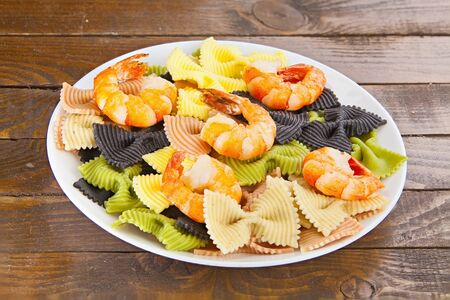 appetizing: appetizing colored farfalle pasta with Tiger chrimp