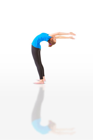 hasta: beautiful flexible woman doing hasta uttanasana on white background Stock Photo
