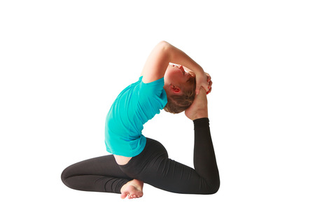 dhanurasana: beautiful flexible woman doing yoguna white background