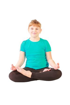siddhasana: beautiful flexible woman doing yoguna white background