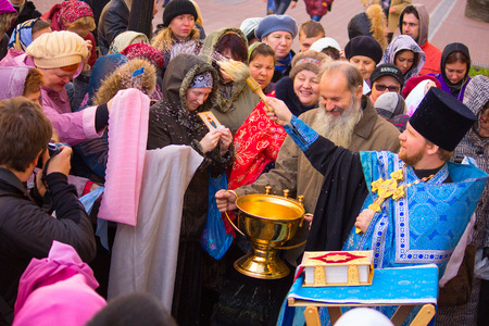 cassock: Orthodox priest sprinkles holy water on worshipers Editorial