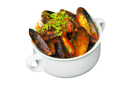 delicious mussels in tomato sauce in a white plate on a white background
