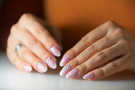 beautiful female manicure isolated on beautiful background