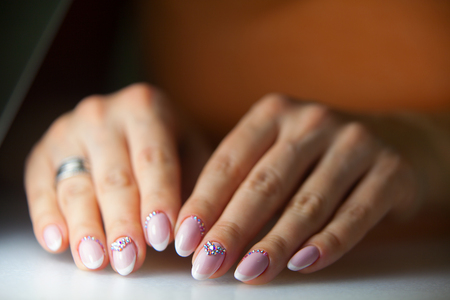 womens hands: beautiful female manicure isolated on beautiful background