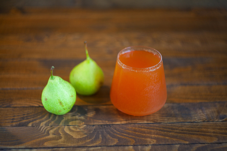 Delicious fresh squeezed pear juice in a transparent glass