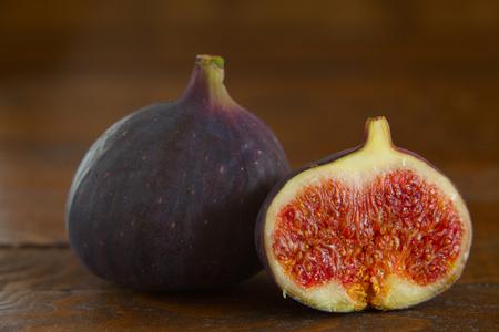 Ripe juicy figs on a brown cutting board