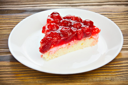 delicious cheesecake with strawberries on a plate