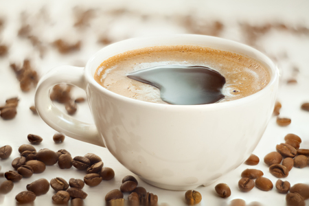 saturated: Hot coffee in coffee cup with natural grains