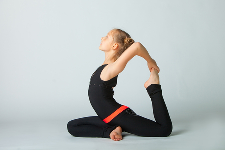 beautiful flexible woman doing yoguna white background