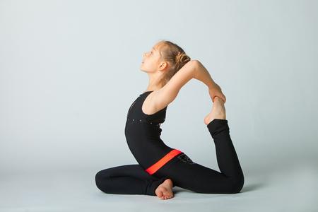 beautiful flexible woman doing yoguna white background Zdjęcie Seryjne - 80924656