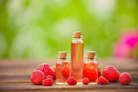 Essence of Wild strawberry on a table in a beautiful glass jar